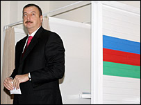 Azerbaijan's President Ilham Aliyev leaves a voting booth