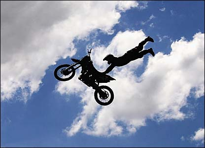 A motocross rider performs a jump during entertainment prior to race four of the A1 Grand Prix of Nations