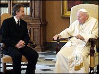 This file photo shows British Premier Tony Blair (L) meeting Pope John Paul II in Vatican City, 22 February 2003