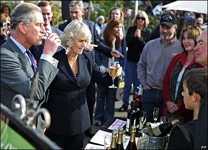Charles and Camilla sampling wine