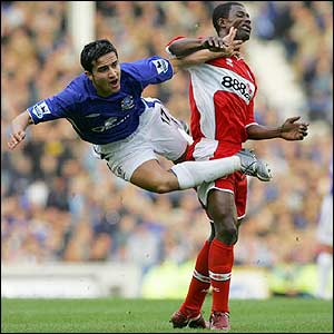 Tim Cahill is sent flying by George Boateng