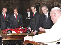 Ferrari drivers Rubens Barrichello, Luca Badoer and Michael Schumacher meet the Pope in January this year