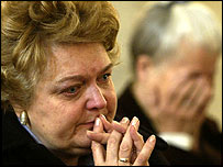 Woman weep while praying for Pope at church in Belgrade, Serbia