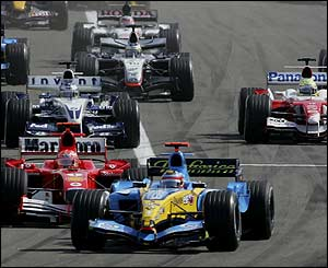 Fernando Alonso stays ahead of Michael Schumacher