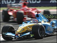 Fernando Alonso holds off Michael Schumacher early in the Bahrain Grand Prix