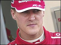 Michael Schumacher leaves the Ferrari pit after retiring from the Bahrain Grand Prix