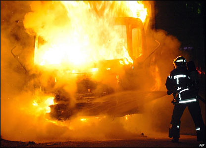 A firefighter extinguishes a truck in Cenon, near Bordeaux, south-western France