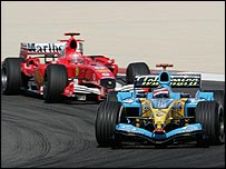 Fernando Alonso's Renault is chased by Michael Schumacher's Ferrari after the Bahrain Grand Prix