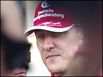 Michael Schumacher is surrounded by reporters after his retirement from the Bahrain Grand Prix