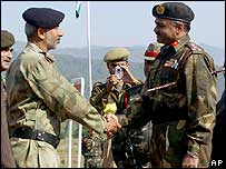 A Pakistani army brigadier (left) shakes hands with his Indian counterpart