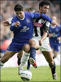 Everton midfielder Mikel Arteta (left) tries to shrug off the attentions of West Brom's Kieran Richardson