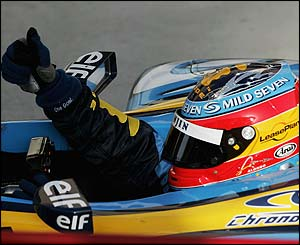 Fernando Alonso celebrates winning in Bahrain