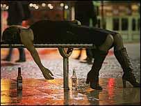Woman drunk on street bench