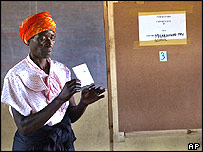 A woman shows her ballet paper before voting in  Zimbabwe