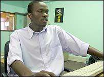 Zimbabwean Mlamuli Nkomo sitting in front of a computer