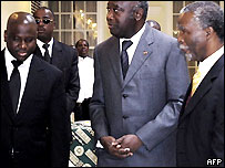 Ivorian rebel chief Guillaume Soro (l), Ivorian President Laurent Gbagbo (middle), South Africa President Thabo Mbeki (right)