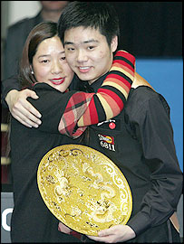 Ding Junhui celebrates his victory with his mother
