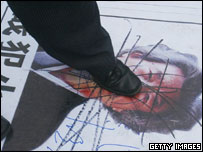 A Chinese man steps on portrait of Japanese Prime Minister Junichiro Koizumi on April 2, 2005 in Guangzhou