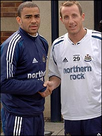 Newcastle's Kieron Dyer (left) and Lee Bowyer shake hands after training on Monday