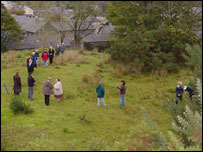 Villagers stand around the boundary of the planned station