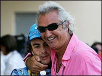 Flavio Briatore embraces Fernando Alonso after his victory in Bahrain