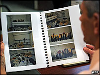 """French policeman looks at photos of Evry petrol bomb """"factory"""""""