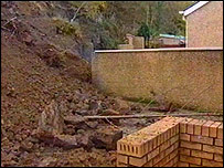 Landslide behind homes