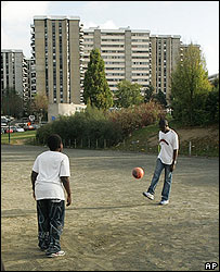 French boys play soccer near their housing estate in Paris
