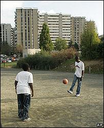 French boys play soccer near their housing estate in Paris