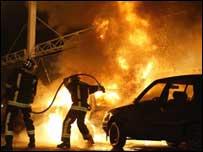 Firefighters tackle a blaze