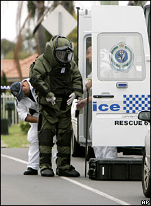 A policeman puts on a protective suit as he prepares to investigate a suspicious package