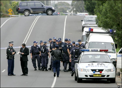 Police man a road block in outer Sydney