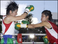 Thailand's Nongmai Sor Siriporn, right, and Nanako Kikuchi of Japan - 7/11/05