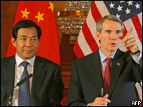 Bo Xilai (left) and Rob Portman making the joint announcement