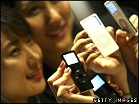 Two girls show off iPod Nanos