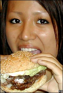 Girl eating whale burger.  Image: AP