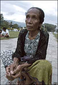 East Timorese woman Natalie da Cruz prays after the death of the Pope