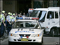 Police watch as a van carrying terror suspects arrives at Sydney's Central Court Tuesday, Nov. 8, 2005.
