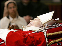 A nun views the body of the Pope