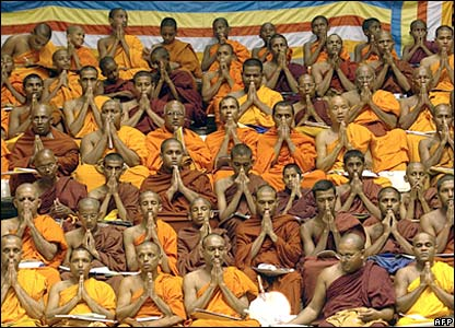 Sri Lankan Buddhist monks pray