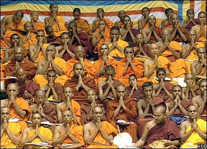 Sri Lankan Buddhist monks pray