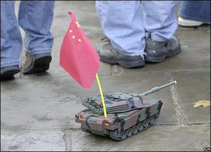 Free Tibet campaigners operate a radio-controlled tank carrying a Chinese flag