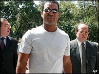 Philadelphia Phillies' pitcher Ugueth Urbina with his lawyers in Caracas, Venezuela