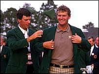 Larry Mize helps Sandy Lyle with his Green Jacket in 1988