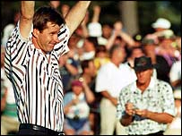 Nick Faldo celebrates his win with beaten rival Greg Norman in the background