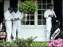Caddies outside Augusta's clubhouse