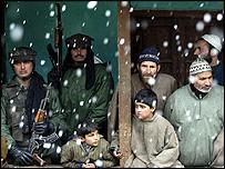 Kashmiris in snowfall