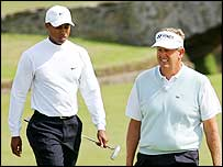 Tiger Woods (left) and Colin Montgomerie walk onto the first green at The Open in 2005
