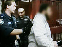 digitally altered video grab from the New South Wales Police, showing one of the suspects being led into a cell, 8 Nov 2005