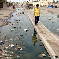 Stagnant water and litter on the streets of Baghdad